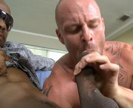 Muscular tattooed gay sucking a big black dick